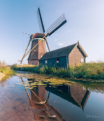 Windmill reflection (rudi.verschoren) Tags: mill water reflection blades house artistic eos europa exposure sky unesco infrastructure outdoor old pittoresque green grass holland heritage kinderdijk landscape lines light mood colors canon nature