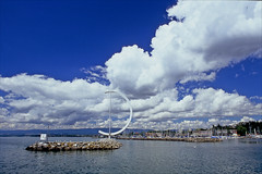 ouchy harbour (Ron Layters) Tags: cloudscape ouchy lausanne marina sculpture lacléman breakwater poles seagulls water lake lakegeneva harbour white blue clouds bluesky vaud switzerland slidefilmthenscanned slide transparency fujichrome velvia leica r6 leicar6 ronlayters highestposition429onsaturdayseptember12018 explore interesting explored
