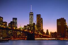 Lights in The City (SunnyDazzled) Tags: manhattan newyork brooklyn bridge river reflections lights city night longexposure cityscape skyscrapers verizon building