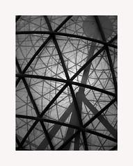 Sevilla 17 (BLANCA GOMEZ) Tags: spain sevilla bw blackwhite arquitectura architecture shadows light patterns exposicionuniversal expo92 universalexhibition bolaclimatica ball silhouettes net ramonvelazquezvila engineering