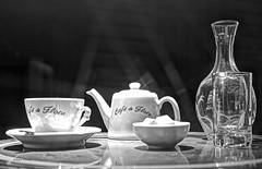 Café de Flore b&w (albyn.davis) Tags: blackandwhite stilllife paris france europe light contrast table tablesetting glassware