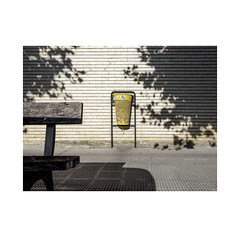 Paper bin.    ( Pamplona ) (José Luis Cosme Giral) Tags: paperbin minimalism urbanfragment urbannature shadow light wall bench olympus pamplona navarra