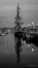 Kaskelot (JKmedia) Tags: kaskelot tallship yacht ship boat harbour plymouth barbican august 2018 boultonphotography mast rigging moored docked calm busy people lights night bw blackwhite reflection