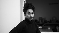 Hélène. (theodirector) Tags: blackandwhite blackwoman stayfocused focus focused concentration unhappy angry look looking beautiful lady youngwoman portrait portraitphotography contrast contraste parisian paris parisiangirl parisianlady frenchwoman prettywoman pretty grumpy afro african
