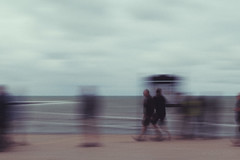 Promenade (shawn~white) Tags: aberystwyth ceredigion fujifilmxt10 icm people uk westwales alteredstate beach coast confidence conviction dream neutraldensity panning playful promenade reminiscing retro seaside trippy vintage ©shawnwhite