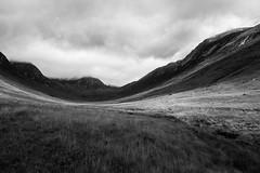 Glen (Raphs) Tags: scotland arran glenrosa valley mountains highlands light shadow monochrome blackandwhite overcast dramatic raphs canoneos70d canonefs1585mmf3556isusm dark clouds gap fv5 grassland