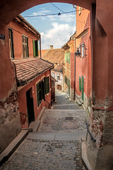 Goldsmith's Stairway, Sibiu, Romania (Aethelweard) Tags: romania sibiu arch stairs stairway historic old steps pink terracotta europe framed cobbles alley descent