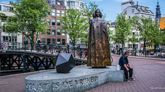 2018 - Amsterdam - Baruch Spinoza (Ted's photos - For Me & You) Tags: 2018 amsterdam cropped nikon nikond750 nikonfx tedmcgrath tedsphotos vignetting nicolasdings nicolasdingsamsterdam statue sculpture streetscene street baruchspinoza baruchspinozaamsterdam benedictdespinoza spinoza spinozasculpture spinozamonument bikes bicycles people peopleandpaths pathsandpeople bridge canalbridge railing railings bronzesculpture bronze bronzestatue bronzeart granite