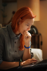 Mary (phyrrula) Tags: beauty girl model portrait redhair naturallight thinking working computer laptop watching focussed wondering sitting