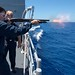 Fire Controlman 1st Class Jordan fires a shotgun during a weapons training exercise aboard USS Antietam