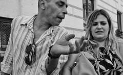 Difference of opinion. (Baz 120) Tags: candid candidstreet candidportrait city candidface candidphotography contrast street streetphoto streetphotography streetcandid streetportrait strangers sony a7 rome roma europe women monochrome monotone mono noiretblanc bw blackandwhite urban life primelens portrait people pentax20mm28 italy italia grittystreetphotography faces decisivemoment