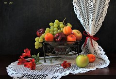 Ripened Summer Fruit (Esther Spektor - Thanks for 12+millions views..) Tags: stilllife naturemorte bodegon naturezamorta stilleben naturamorta composition creativephotography summer tabletop fruit apple apricot grape flowers alstromeria stand bowl curtain ribbon bow glass metal lace pattern ambientlight white green red orange burgundy brown black estherspektor canon