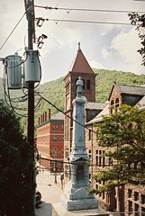 DR1-025-11 (David Swift Photography) Tags: davidswiftphotography pennsylvania jimthorpepa carboncountycourthouse civilwarmonuments electriclines clocktower historicbuildings historicplaces 35mm nikonfm2 kodakportra film architecture monuments statues
