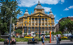 2018 - Hungary - Budapest - Architecture (Ted's photos - For Me & You) Tags: 2018 budapest cropped hungary nikon nikond750 nikonfx tedmcgrath tedsphotos vignetting budapesthungary building streetscene street people peopleandpaths pathsandpeople seating seats seated bench benches backpack taxi cab