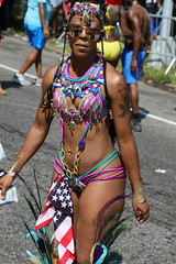 naturally thick (Chuck Diesel) Tags: westindiandayparade2018 caribbeancarnival costume masquerader brooklyn nyc easternparkway newyorkcity seeitfromthefront phatass booty butt slimwaist flatstomach fitthick sexy thighs americanflag tattoos sunglasses fitness