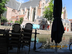Early morning (RubyGoes) Tags: cafe chairs trees church man green amsterdam netherlands canal bikes blue sky windows doors roof reflection
