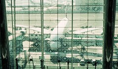 Through the Glass (Harald Philipp) Tags: architecture building glass structure geometric geometry window airplane car cars holiday vacation tourism tourist destination travel adventure wanderlust kodak portra 35mm film grain analog filmphotography kodakretina retinaiiic classiccamera rangefinder antiquecamera foldingcamera dubai airport a380 tarmac aircraft terminal departurelounge