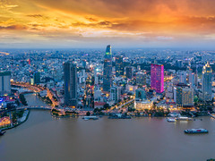Aerial view of Ho Chi Minh City skyline and skyscrapers in center of heart business at Ho Chi Minh City downtown. Panorama of cityscape on Saigon river in Ho Chi Minh City at Vietnam at sunset scene (MongkolChuewong) Tags: aerial aerialview architecture building business chi city cityscape condominium construction destination district drone dusk famous hall high ho hochiminh landmark landscape minh modern morning night office panorama panoramic port reflection river royalty saigon sky skydeck skyline skyscraper skyscrapers sunrise sunset tourism tower traffic travel urban vietnam vietnamese view water hochiminhcity hồchíminh vn