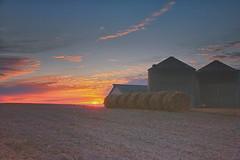 morning glow (wdterp) Tags: sunrise cloudsstormssunsetssunrises winter farm bales country bins morning dawn