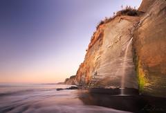 To the sea (Luc Stadnik) Tags: cliffs seascape tasmansea newplymouth newzeanland waterfall beach sunset