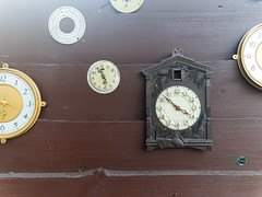 Collection of vintage clock hanging on an old wooden wall on the outdoors with sunshine (lyule4ik) Tags: clock wall vintage old time many different round white hanging brick square late watchmaker long meeting collection abandoned adjust antiques arelocated broken check collect compare coverseams date decorative dial direction display epoch group installation lie masonry mold operatingmechanism outdoors outside placed restored shape short stains stylization tsyfry antique background concept