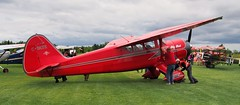 Big Red - 1944 Stinson V77 Reliant, C-FATE - Great War Flying Museum fly-in, Caledon, Ontario.. (edk7) Tags: olympusomdem5 panasoniclumixg20mm117iiasphpancake edk7 2018 canada ontario caledon bramptoncaledonairport greatwarflyingmuseum gwfm stinsonv77reliant cn77291 1944 cfate bigred stinsongullwing aircraft plane airplane civilian passenger aviation propeller propellor grass cloud lycomingr680e3bninecylinderradial300hp