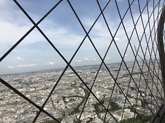 033 - Eiffel Tower View (EllieSmithPhotos) Tags: eiffel tower view tourists tourism buildings clouds grey wire bars area people high height tall paris france distance trees greenery structures photo photograph photography iphone 7 phone camera image imagery picture focus angle