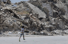The escape (Hasan Blal) Tags: syria aleppo old damaged escape hell boy children building war crisi isis army road people rocks
