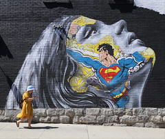 Cell phones: The kryptonite that weakens your mind. (Alex L'aventurier,) Tags: montreal montréal quebec québec canada street rue candid superman wowan femme art murale graffiti mur wall briques bricks shadows ombre urban city ville