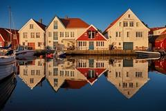 Summer ending (Vest der ute) Tags: xt20 sea water buildings houses reflections mirror bluesky sky serene boat evening sunset fav25