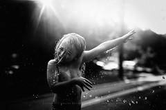 Sibling wars... (privizzinis passion photography) Tags: blackandwhite light lighting sunshine backlight sunflare freelensed freelensing people child children childhood water summer outdoors outdoor boy