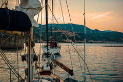 Sunrise start...... (Dafydd Penguin) Tags: sail sailing sailboat boat yacht yachting leaving harbour harbor port dock marina bay anchorage sea cruising coasting coast italy cetrato mediterranean south leica m10 7artisans 50mm f11