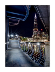 Under London Bridge (Dave Fieldhouse Photography) Tags: londonbridge london river riverthames night nighttime lights illumination theshard shard skyscraper tower shangilahotel handrail pavement dark skyline londonbridgehospital portrait framing fujixt2 fujifilm fuji wwwdavefieldhousephotographycom appicoftheweek