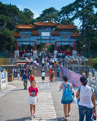 2018 Beijing - Summer Palace Gardens 019 (C & R Driver-Burgess) Tags: 颐和园 北京 path pavement child girl pink white shorts tshirt arch ornate decorated painted wooden gate orange tile roof steps stairs