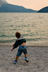 To be young (Marco MCMLXXVI) Tags: molveno trentino italy lake water child young serenity serene sunset action lago tramonto serenità giovinezza youth life moment sony nex5 rawtherapee outdoor scenery landscape humanity summer acqua hills mountains