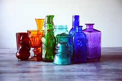 assorted-bottles-bright-1148450 (toptenalternatives) Tags: ssorted bottles bright clean clear closeup collection colorful colors containers decor display empty fragile glass glassware home jar multicolor table