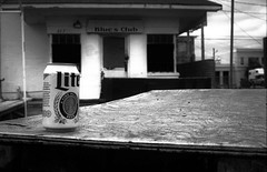 Last Can Standing -- Juke Joint Festival, Sunday Morning (forestforthetress) Tags: jukejointfestival clarksdale music blues theblues deltablues omot nikon bw blackandwhite beer festival outdoor building alcohol fun