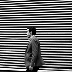Along the rows (pascalcolin1) Tags: paris13 homme man mur wall rayures lined rayé photoderue streetview urbanarte noiretblanc blackandwhite photopascalcolin 50mm canon50mm canon carré square