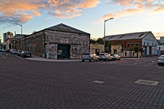 THE REFURBISHED KENT RAILWAY STATION AND NEARBY [PHOTOGRAPHED AT SUNSET IN SEPTEMBER 2018]-144407 (infomatique) Tags: thomaskent trainstation memorial glanmireroadstation hogansquay transport publictransport busservice bikehire williammurphy sunset sony a7riii streetphotograpgy irishrail cie