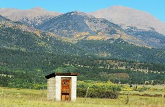 Privy With a View (Patricia Henschen) Tags: fall colors frontierpathwaysscenichistoricbyway frontierpathways sanisabelnationalforest nationalforest custer county colorado mountains road roadside trip pathscaminhos rural countryside wet sanisabel sangredecristo aspen privy outhouse halfmoon school vintage westcliffe autumn leafpeeping