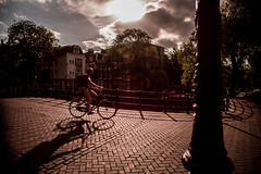 the approach of autumn (Gerrit-Jan Visser) Tags: amsterdam autumn bicycle bridge clouds movement streetphotography sun wind netherlands shadow city canals