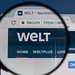 Welt logo on a computer screen with a magnifying glass.jpg