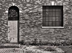 Door and Window (EssGee Photography™) Tags: floydbennettfield lumixlf1 newyork travel tourist industrial gatewaynationalrecreationarea doorway door digital decay building brooklyn brick blackwhite blackandwhite artdeco architecture abandoned bw