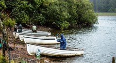 Anglers and their boats (allybeag) Tags: glencorse reservoir boats anglers fishermen rain outdoorgear waterproofs