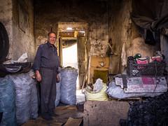 Coal shop keeper, Esfahan (TeunJanssen) Tags: iran esfahan isfahan bazar bazaar store market shop middleeast travel traveling worldtravel worldtrip backpacking olympus omd omdem10 man coal portrait