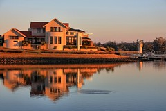 Reflections of suburbia. (Ian Ramsay Photographics) Tags: portmacquarie newsouthwales australia refelctions suburbia water hours morning sun emerged horizon disturbance fish ripple jumping greet day