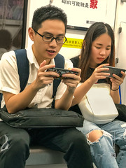 People in China (Shenzhen) #3, candid shot with iPhone X, 08-2018, (Vlad Meytin, vladsm.com) (Instagram: vlad.meytin) Tags: china khimporiumco meytin shenzhen vladmeytin asia asian boyandgirl candid casual chinese city face guy iphone iphonex oriental outdoor people person photography pictures playingwithphones portrait portraits publictransportation streetlife streetphotography streetscene streets style subway teenagers urban vladsm vladsmcom 中国 中國 深圳
