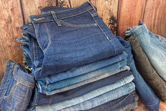 Various shades of jeans stacked on a wooden background (zaklina.miljkovic) Tags: abstract apparel background black blue bluejeans canvas casual classic close closeup cloth clothes clothing color cotton denim design detail fabric fashion fold garment jeans light material modern outfit pants pattern pile pocket retro seam sewing stack stacked stitch style textile texture textured threadbare traditional trousers various wear wooden worn