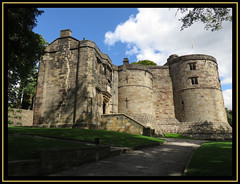 Skipton Castle. (M E For Bees (Was Margaret Edge The Bee Girl)) Tags: skipton castle northyorkshire fortress stone architecture old ancient towers blue sky sun summer shadows trees town canon flag grey