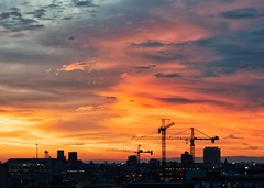 Silver and Gold (BlinkOfALens) Tags: chicago illinois unitedstates us sunset construction clouds silhouette cityscape dramatic